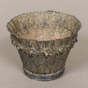 An unmarked silver filigree bowl Of typical scroll pierced form,