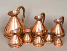 A set of eight 19th century copper harvest jugs Comprising: one gallon, half, quart, pint,