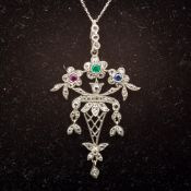 A vintage 9 ct white gold ruby, emerald,