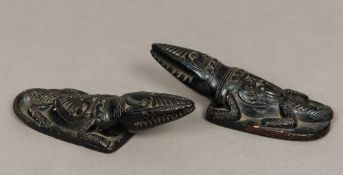 A pair of Indian ebonised terracotta scarafiers Worked as crocodiles. 16 cm long.
