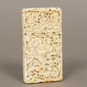 A small late 19th century Canton ivory card case Carved in the round with various figures amongst