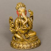 An Indian gilt bronze figure of Ganesh Of typical form, the head with painted detail. 9.5 cm high.