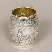 A George III silver Christening mug, hallmarked London 1801, maker's mark of JW Of barrel form,