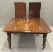A Victorian mahogany extending dining table The rounded rectangular top incorporating two leaves