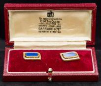 A pair of Edwardian 18 ct gold and lapis lazuli set cufflinks Each of pierced stylised rectangular