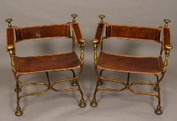 A pair of Continental 20th century metal framed leather X-framed chairs 65 cm wide.