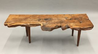 A rustic country yewwood bench/window seat Of basic gnarled plank form,