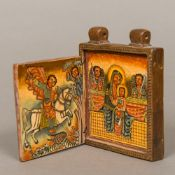 A carved wood Coptic travelling icon The geometrically carved front and back enclosing religious