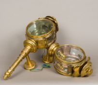 A pair of unusual 19th century brass coaching lamps Each of circular form with bevelled glass,