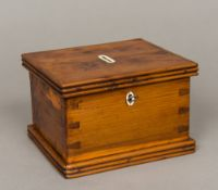 An early 19th century yewwood money box The hinged cover with reeded edge,