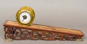 A 19th century inclined plane gravity timepiece The white enamelled dial with Arabic numerals,
