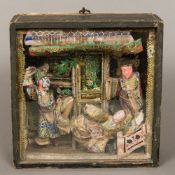 A 19th century Chinese cased figural diorama Formed as a theatrical group. 24 cm high.