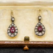 A pair of Victorian 18 ct gold diamond and almandine garnet earrings Each of oval drop form.