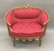 A 19th century French giltwood framed upholstered settee Of small proportions,