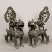 A pair of large Chinese patinated bronze models Each formed as a dog-of-fo with Buddha seated on