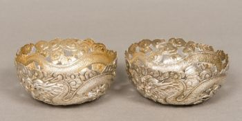 A pair of late 19th/early 20th century Chinese silver bowls Each pierced and worked with a dragon