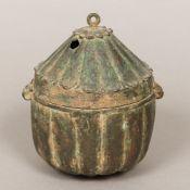 An 18th century Indian patinated bronze box Of ribbed circular form,