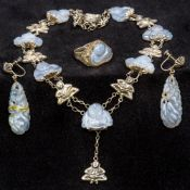 A suite of Chinese silver mounted lavender jade jewellery Comprising: a necklace set with Buddhas,