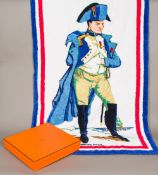 A Hermes cotton towel Worked with the figure of Napoleon within a tricolour border, signed Hermes,