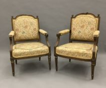 A pair of 19th century French upholstered carved giltwood open armchairs Each arched padded back