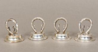 A set of four Edwardian silver menu holders, three hallmarked Birmingham 1906, one Birmingham 1907,