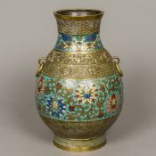 A late 19th/early 20th century Chinese cloisonne twin handled vase Of baluster form,