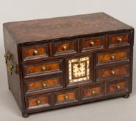 An 18th century Indo-Portuguese parquetry inlaid table cabinet Fitted with an arrangement of