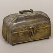 An 18th century Indian bronze box Of hinged domed shaped rectangular form,