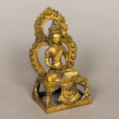 A gilt bronze figure of Buddha Typically modelled in the lotus position,