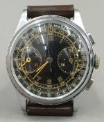 A mid-20th century gentleman's chronograph wristwatch With military style black multi-dial. 3.