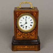 A 19th century French marquetry inlaid rosewood cased mantle clock by Bolviller The white enamelled