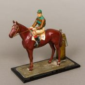An early 20th century cold painted spelter table lighter Formed as a racehorse with jockey up,