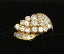An 18 ct gold and diamond cluster ring Set with twenty-four diamonds. 1 cm high.