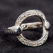 An 18 ct white gold diamond set Asanti Karma ring Of typical circular form,