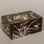 A late 19th century Oriental mother-of-pearl inlaid lacquered box Of rectangular form,