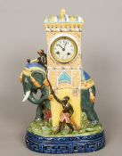 A large majolica pottery clock Formed as an elephant being ridden by a monkey smoking a pipe,