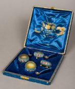 A set of four Russian enamel decorated silver gilt salts, each indistinctly marked to base,