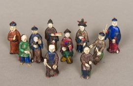 A collection of 19th century Chinese painted carved ivory figures Variously modelled.