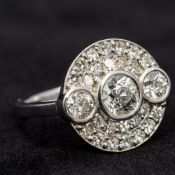 An 18 ct white gold pave set diamond ring Of circular form, set with approximately 2.