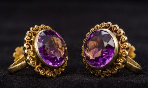 A pair of 15 ct gold amethyst set clip-o