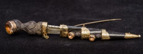 An unmarked gold mounted citrine set car