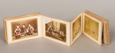 A late 19th/early 20th century Japanese concertina album Enclosing coloured photographic prints of