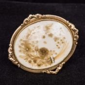 A Regency unmarked gold framed brooch