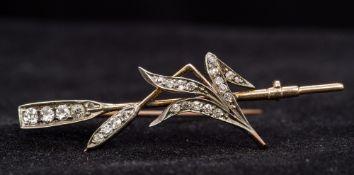 An unmarked gold diamond set bar brooch