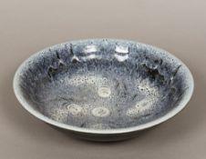 A Studio pottery bowl The interior with souffle glaze, impressed mark GA to base. 39.5 cm diameter.