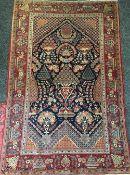 A Kashan wool prayer rug, circa 1920