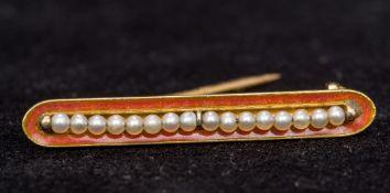 A Boucheron enamel and seed pearl set go