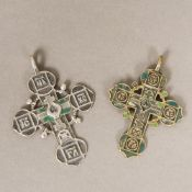 An antique Greek unmarked white metal cross Of typical form, with traces of coloured decoration,