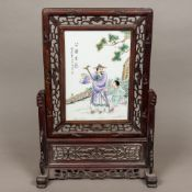 A Chinese porcelain mounted wooden frame
