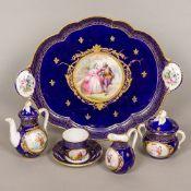 A 19th century Continental porcelain tea set Comprising: a tray, teapot, sucrier,